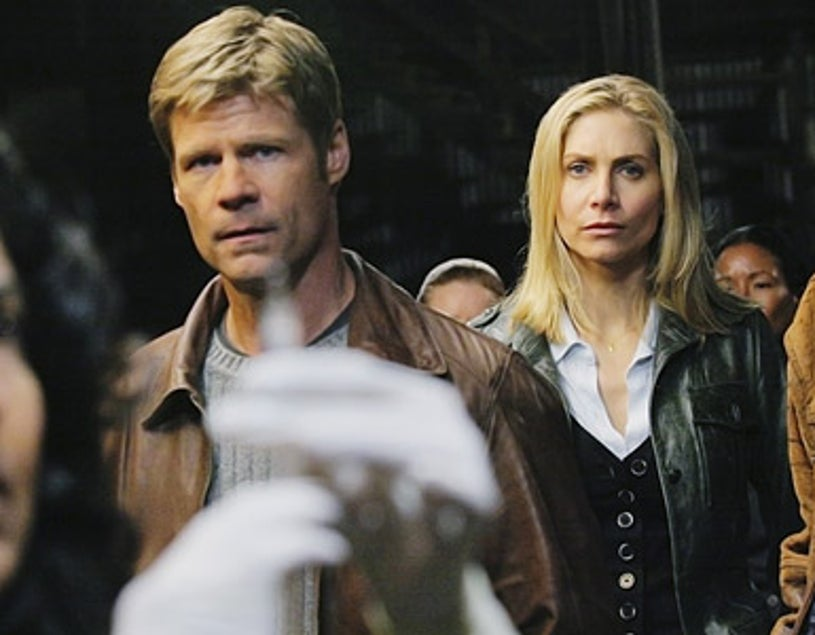 V - Joel Gretsch as Father Jack Landry and Elizabeth Mitchell as Erica Evans