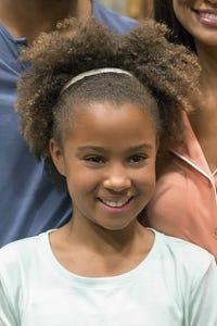 Corinne Massiah as May Grant