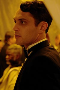 Colin Woodell as Aiden
