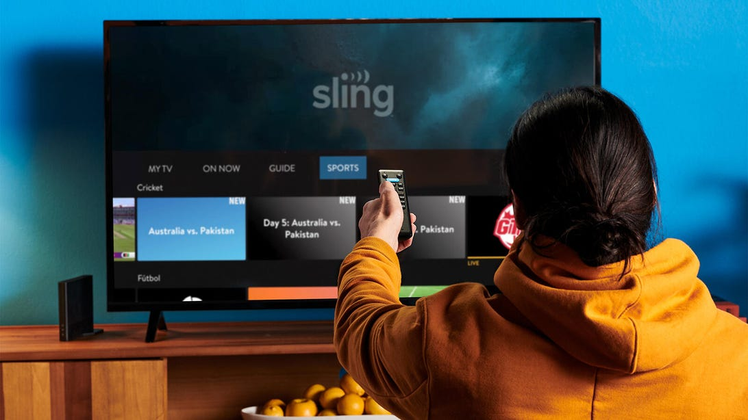 Person watching Sling TV screen