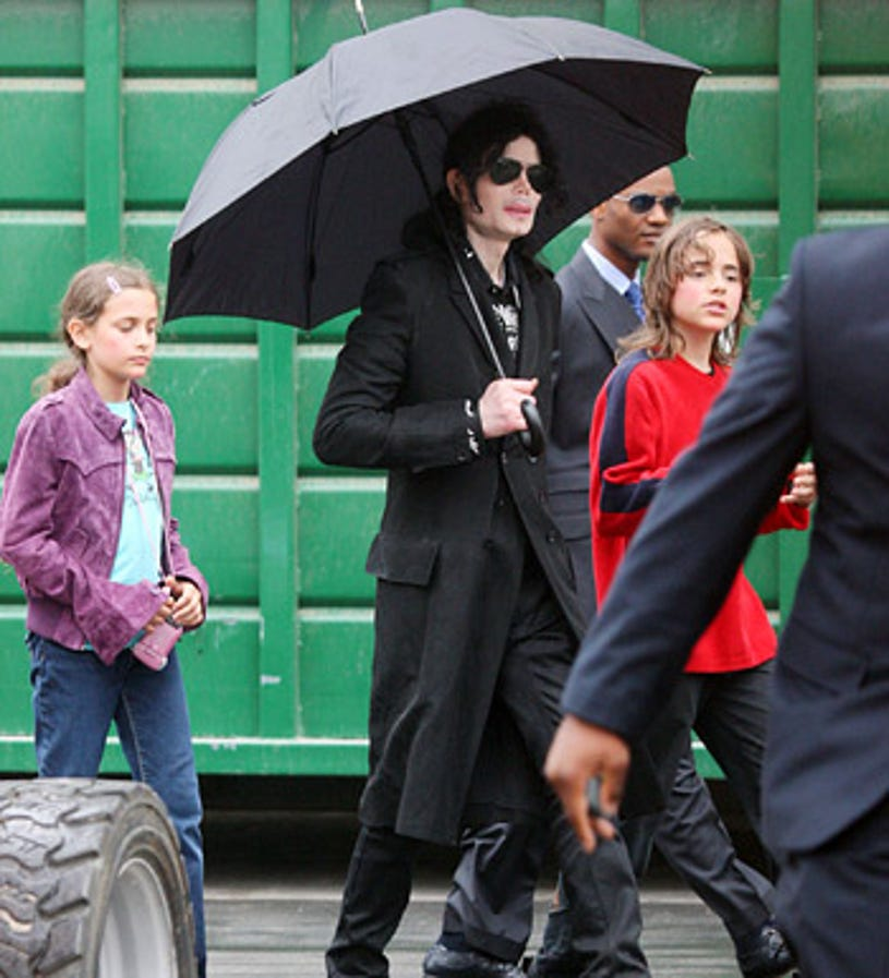 Michael Jackson with his children Paris and Prince  - walking through a studio parking lot iin Los Angeles, June 3, 2009