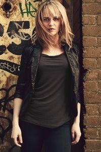 Sprague Grayden as Olivia Baird