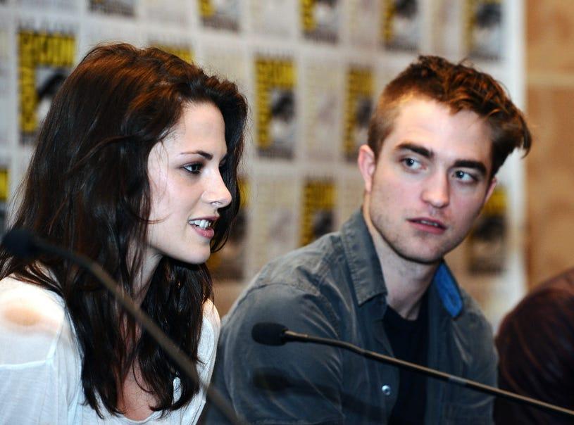 "Kristen Stewart and Robert Pattinson speak onstage at Summit Entertainment presents ""The Twilight Saga: Breaking Dawn - Part 1"" Press Conference on July 21, 2011, Comic-Con"