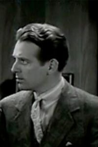 Wallace Ford as Charles J. Hennessey