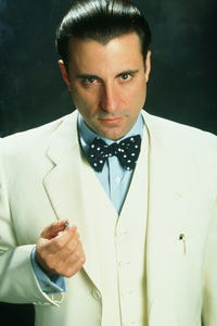 Andy Garcia as Slick Publisher