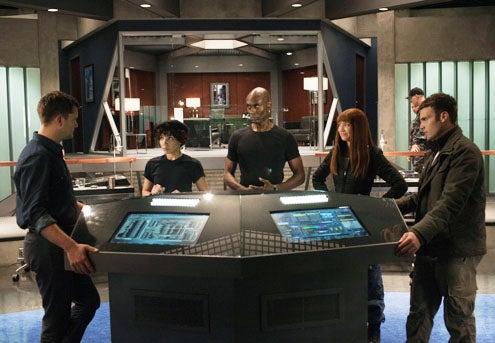 "Fringe - Season 4 - ""Enemy of My Enemy"" - Joshua Jackson as Peter Bishop, Jasika Nicole as Alt. Astrid, Lance Reddick as Alt. Broyles, Anna Torv as Bolivia and Seth Gabel as Lincoln Lee"
