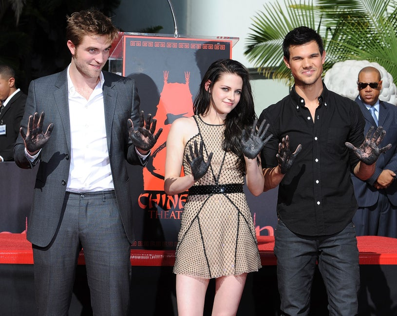 "Robert Pattinson, Kristen Stewart and Taylor Lautner pose at ""The Twilight Trio"" Hand/Foorprint Ceremony at Grauman's Chinese Theatre on November 3, 2011"
