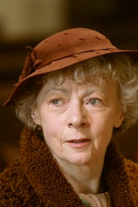 Joan Hickson as Mrs. Fenton