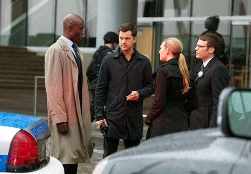 "Fringe - Season 4 - ""Forced Perspective"" - Lance Reddick as Phillip Broyles, Joshua Jackson as Peter Bishop, Anna Torv as Olivia Dunham and Seth Gabel as Lincoln Lee"