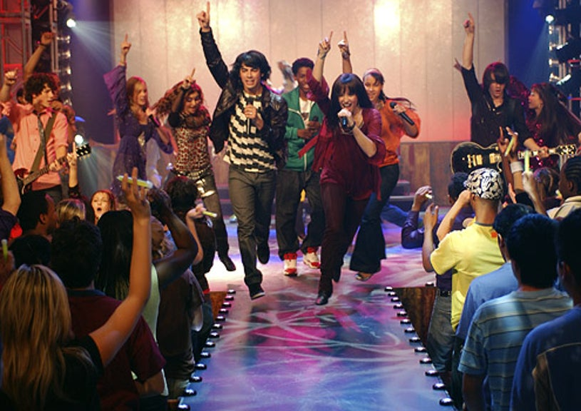 Camp Rock - Joe Jonas as Shane and Demi Lovato as Mitchie with Camp Rock dancers and cast