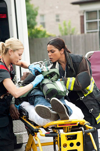 """Chicago Fire - Season 1 - """"Rear View Mirror"""" - Lauren German and Monica Raymund"""