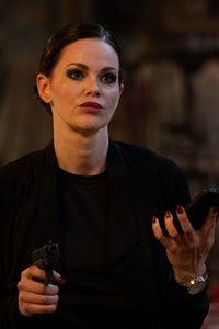 Lydia Hull as Front Desk Clerk