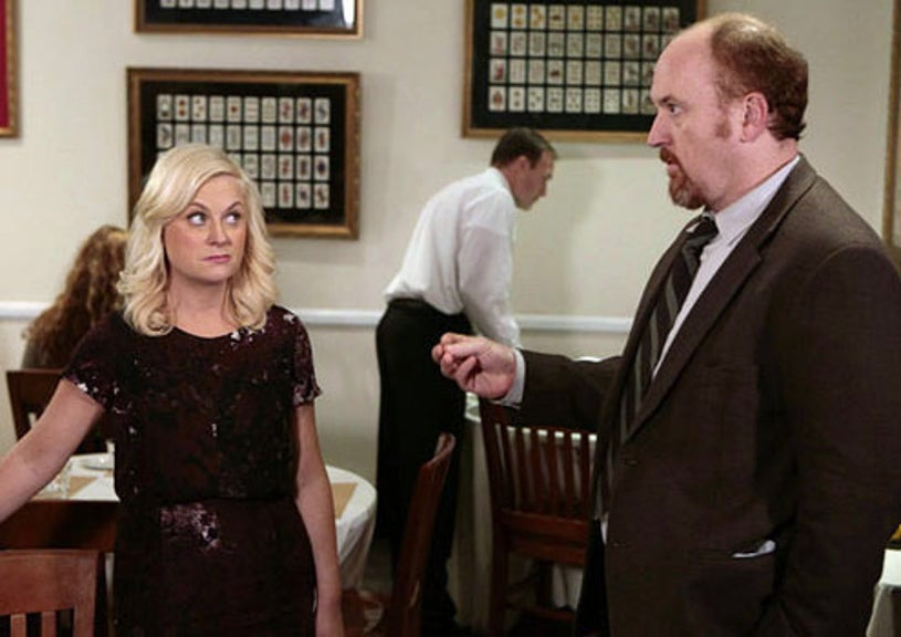 """Parks and Recreation - Season 4 - """"Dave Returns"""" - Amy Poehler as Leslie Knope and Louis C.K. as Dave Sanderson"""