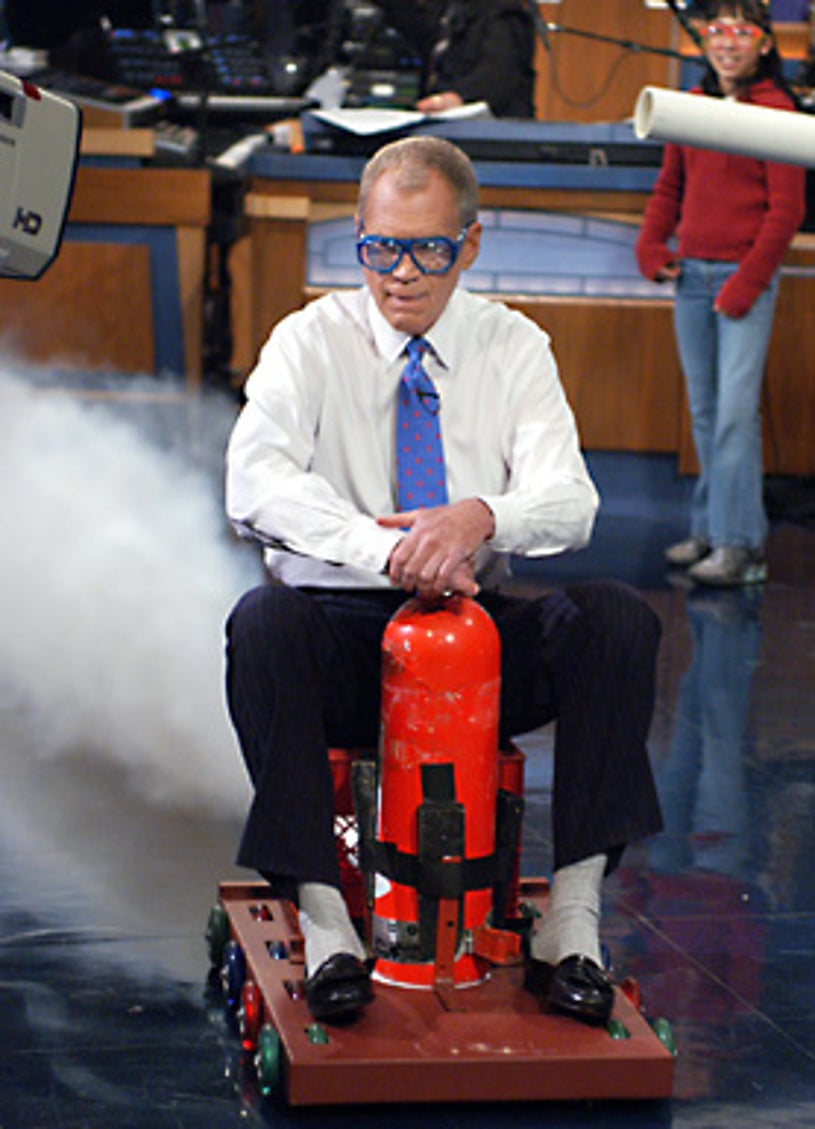 "The Late Show with David Letterman - David Letterman takes a ride on a sled powered by a fire extinguisher during the Tuesday 2/15/2005 taping in New York with ""Kid Scientists"" from Napierville, Illinois."
