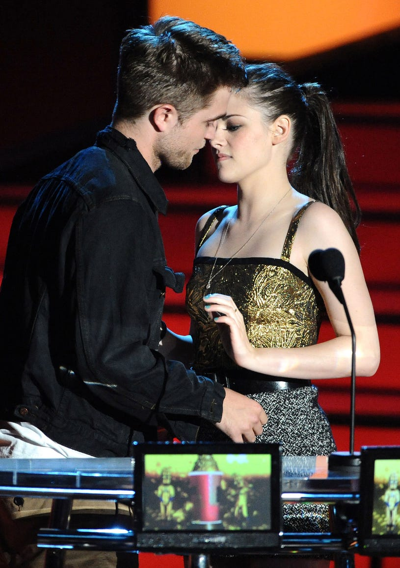 Robert Pattinson and Kristen Stewart onstage at the 2010 MTV Movie Awards at Gibson Amphitheatre on June 6, 2010