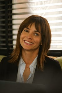 Stephanie Szostak as Grace Truman