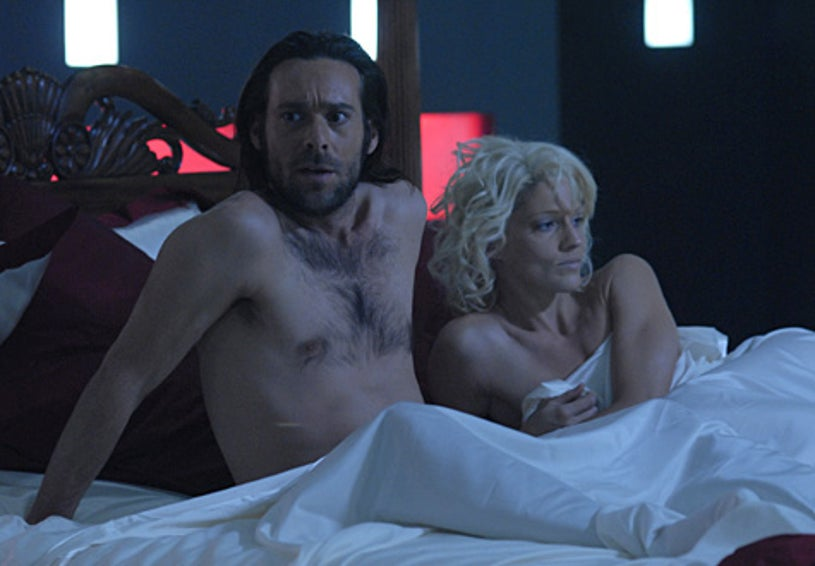 "Battlestar Galactica - Season 3 - ""The Passage"" - James Callis as Dr. Gaius Baltar and Tricia Helfer as Number Six"