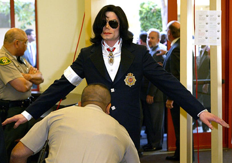 Michael Jackson - being friske by and officer on arrival at the Santa Barbara courthouse, January 16, 2004