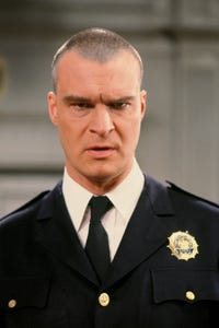 Richard Moll as Prison Attendant