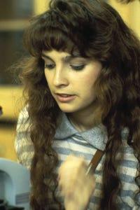 Estee Chandler as Female Teller