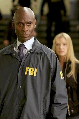 "Fringe - Season 3 - ""Olivia"" - Lance Reddick as Phillip Broyles and Anna Torv as Olivia Dunham"