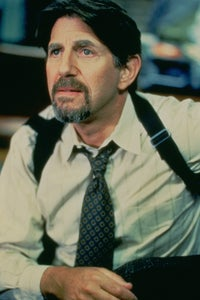 Peter Coyote as Mark August