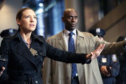 "Fringe - Season 4 - ""Forced Perspective"" - Anna Torv as Olivia Dunham and Lance Reddick as Phillip Broyles"