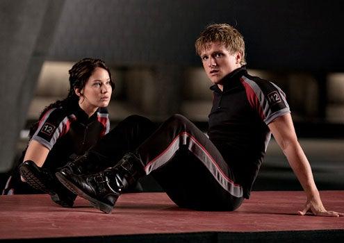 The Hunger Games - Jennifer Lawrence as Katniss Everdeen and Josh Hutcherson as Peeta Mellark
