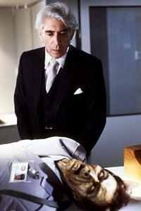 Frank Finlay as Retired Diplomat