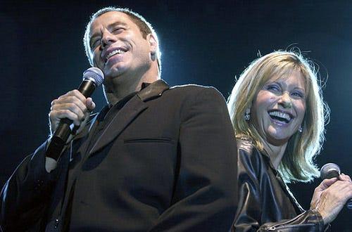 "John Travolta and Olivia Newton-John - Paramount's releases of ""6 All-Time Musical Favorites"", September 24, 2002"