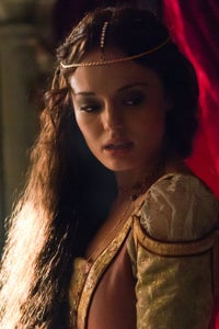Laura Haddock as Miss Grosvenor