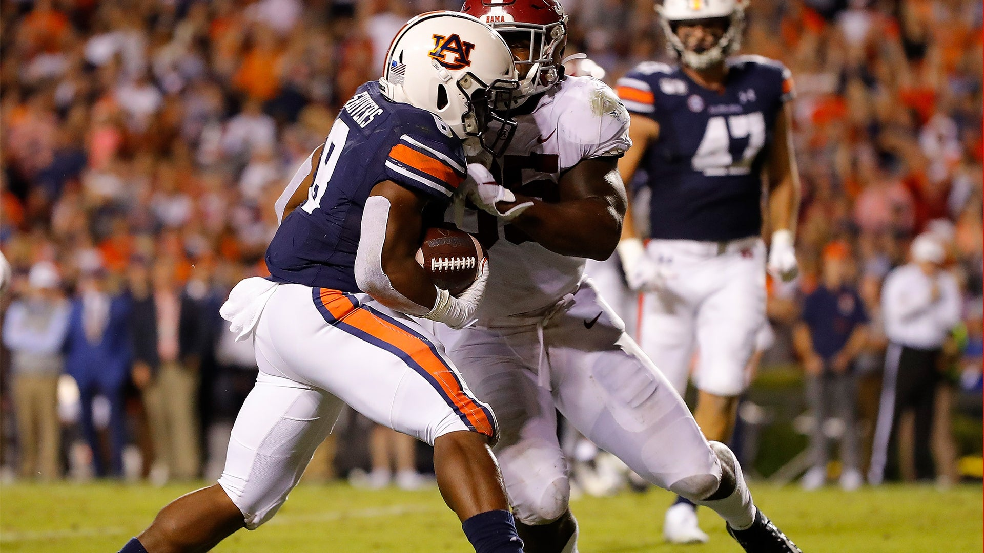 Shaun Shivers of the Auburn Tigers rushes for a touchdown in the second half against Shane Lee of the Alabama Crimson Tide