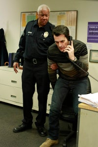 Rick Fitts as Police Officer