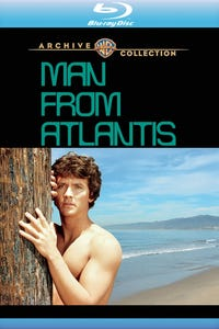 Man from Atlantis as Woman at Party