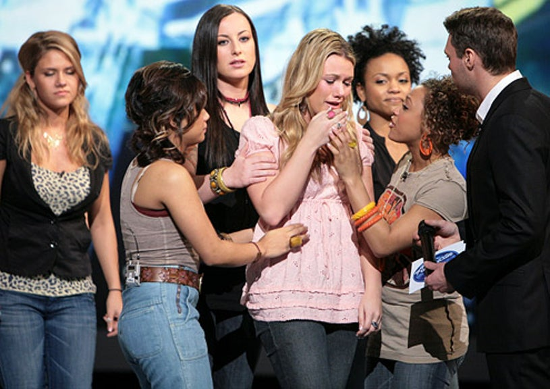 American Idol - Season 7 - The female contestants and Ryan Seacrest comfort the eliminated Alaina Whitaker