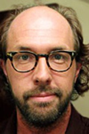 Eric Lange as Simon Warburg