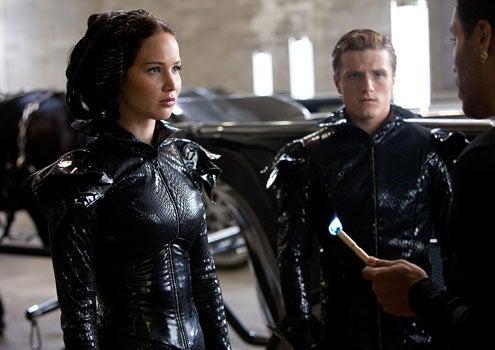 The Hunger Games - Jennifer Lawrence as Katniss Everdeen, Josh Hutcherson as Peeta Mellark and Lenny Kravitz as Cinna