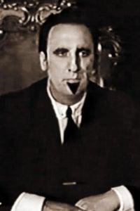 Timothy Carey as Preacher