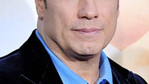 Travolta Donates to Nelson Mandela Children's Fund