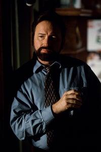 John Ritter as Charles Rutledge