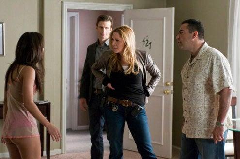"In Plain Sight - Season 2 - ""Jailbait"" - Francia Raisa as Olivia Moreno/Morales, Frederick Weller as Marshall Mann, Mary McCormack as Mary Shannon, Carlos Gomez as Jesus Moreno/Morales"