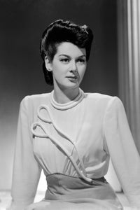 Rosalind Russell as Mrs. Jacoby