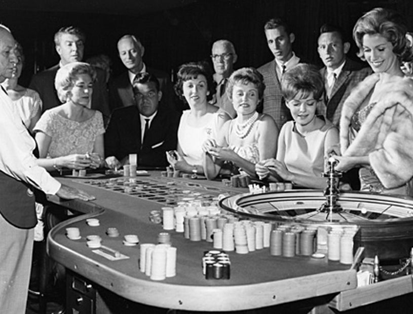 """American Experience - """"Las Vegas: An Unconventional History"""" - Gamblers playing roulette at the Sands casino."""