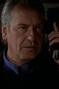 Patrick Bauchau as Caine Powell