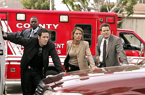 "Numb3rs - ""Burn Rate"" - Rob Morrow as Don, Lisa Vidal as Jennifer Malloy, Dylan Bruno as Colby"